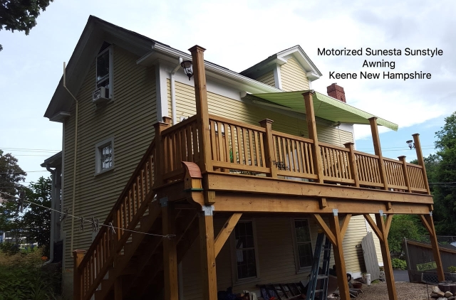 green and white striped somfy motorized retractable awning