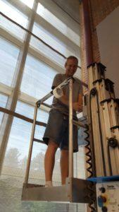 Kieth on a genie lift a UNH MUB building