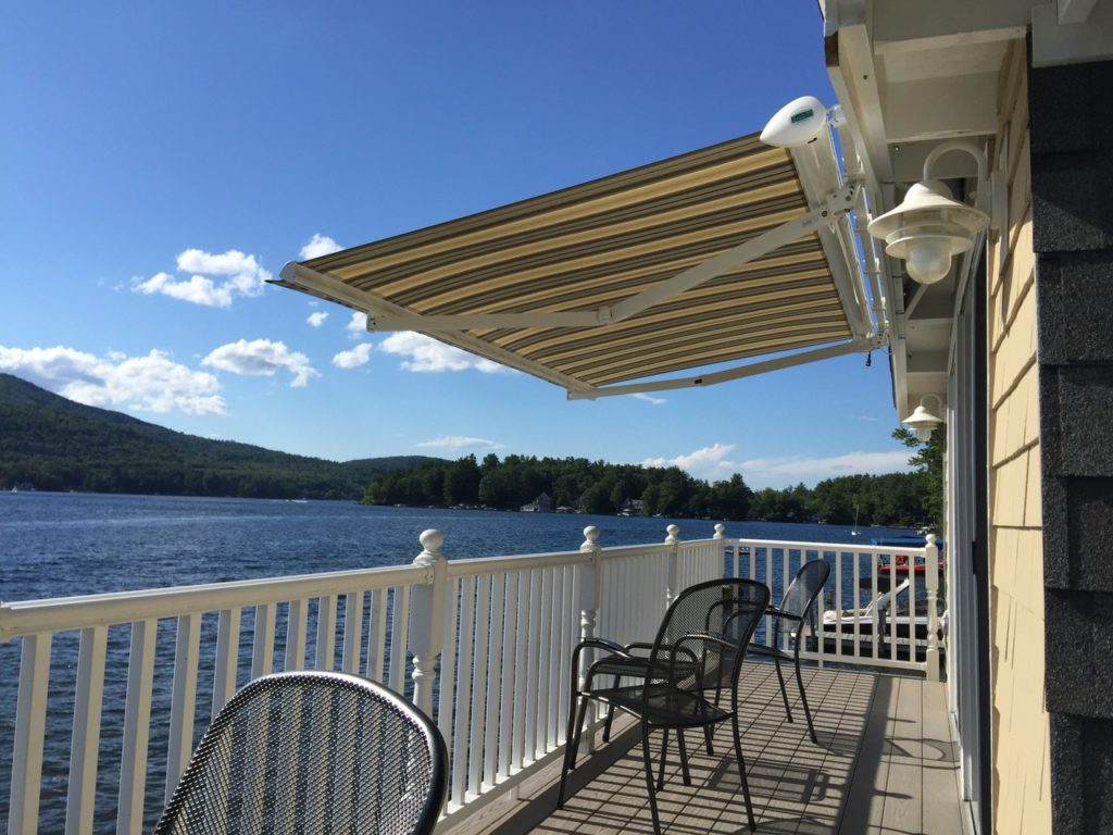 Alton bay Lake Winnipesaukee NH boat house with retractable power Awning