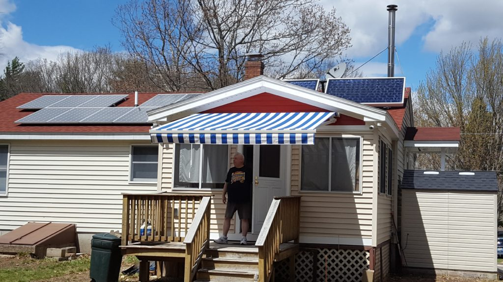 Awning and solar panels