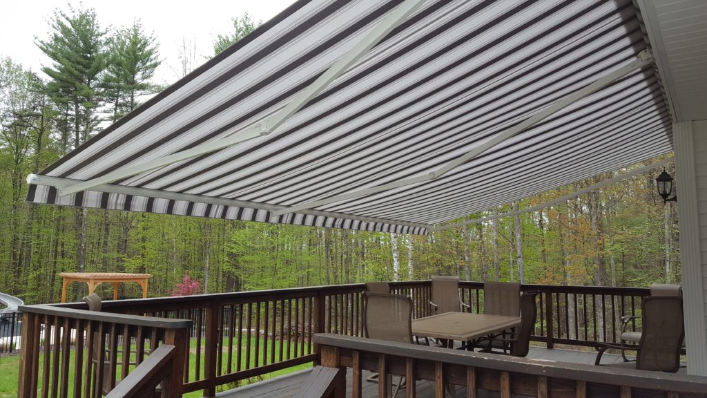 Custom size and color awning complete this deck