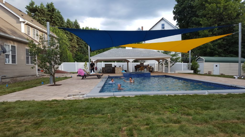 Swimming under the protection of dual UV blocking Shade Sails