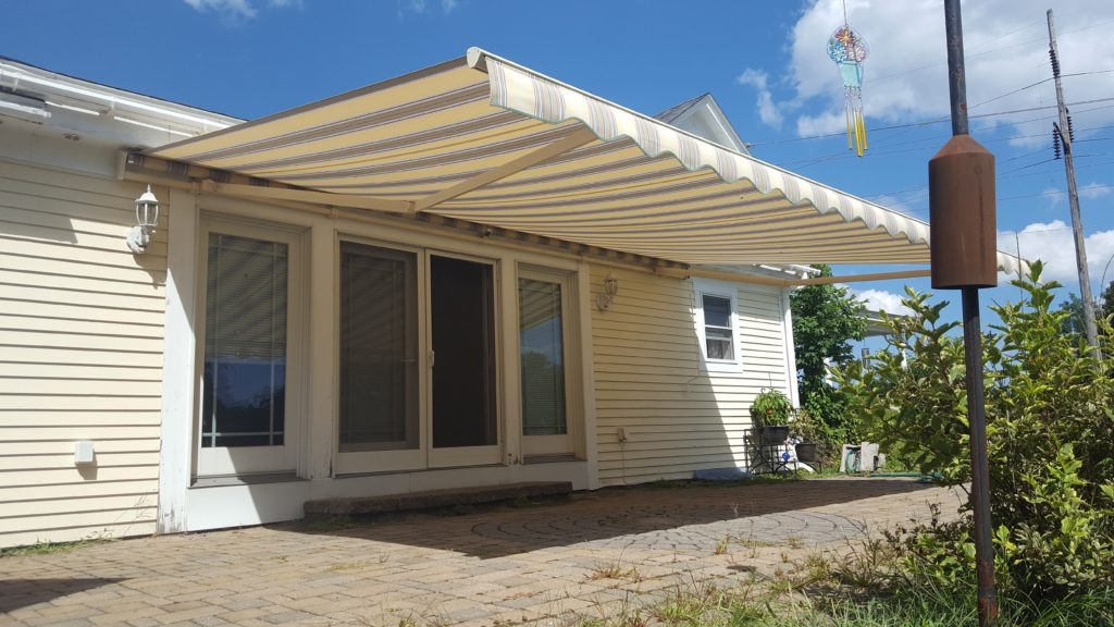 attractive striped awning in new durham NH