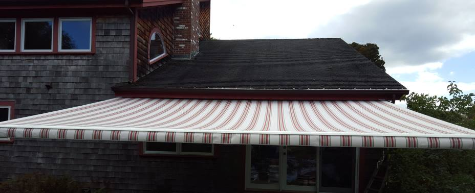 Large retractable awning  installed on a Rumney. NH home
