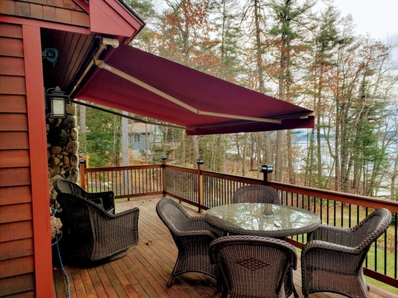 Maroon Sunesta retractable awning in Waterville Valley NH