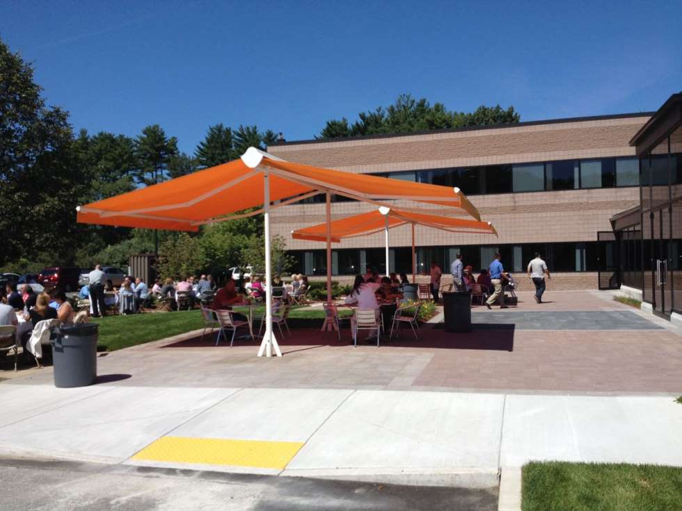 corporate party under a shadespot retractable awning