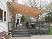 deck with a large awning over it