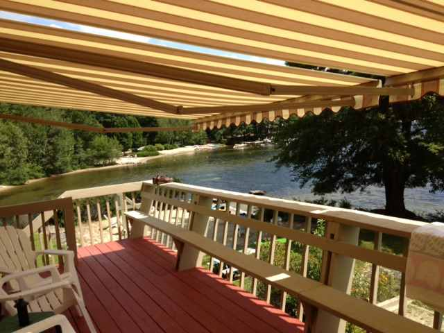 red deck awning on a lakefront home