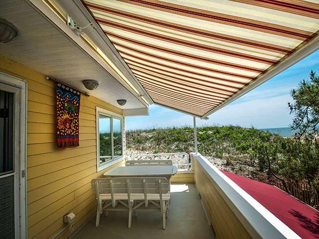 sunesta sunplus striped retractable awning