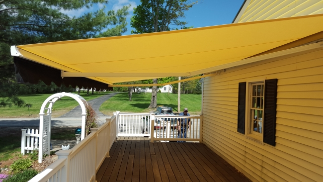 yellow retractable awning on a home