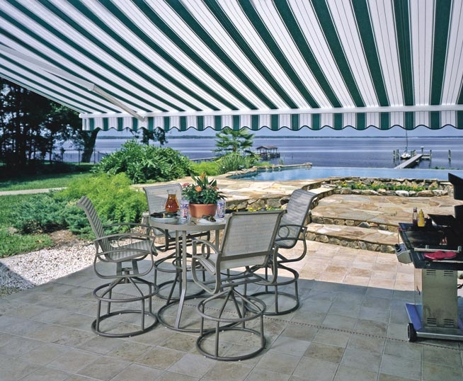 a blue striped sunesta awning on a patio