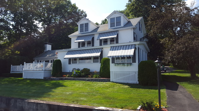 4 remote control awnings on a large house