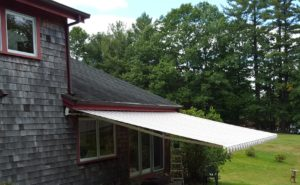 Large projection Sunesta awning on a Squam Lake energy efficiant home