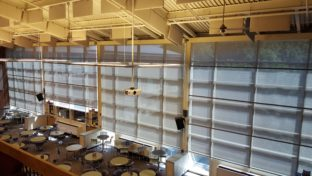 Four large solar screens at the UNH MUB buildiing