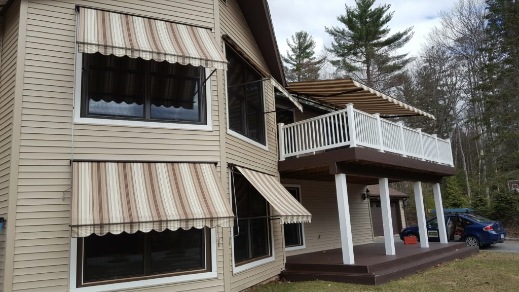 Light brown stripes enhance the look of this Lake Newfound home