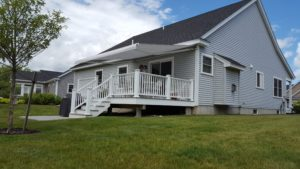 custom light gray awning matches the home and cools deck and home
