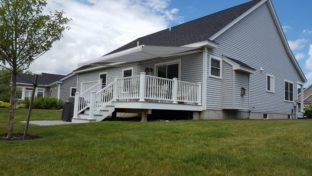 custom light gray awning matchs home and cools deck and home