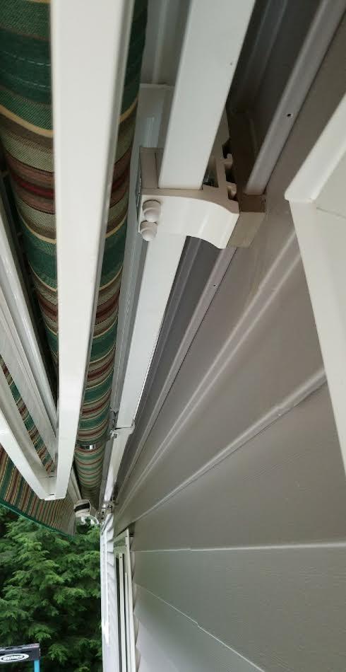 Gray blocs match siding on this Sunesta retractable awning