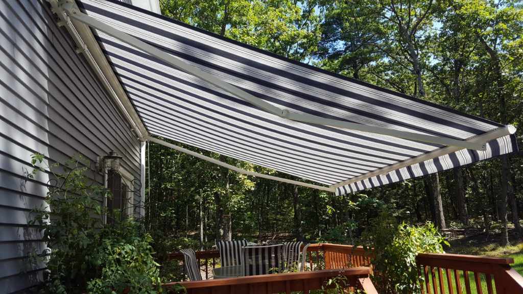 Sunesta motorized awning gives needed projection to not only shade the deck but to shed the rain in Windham NH