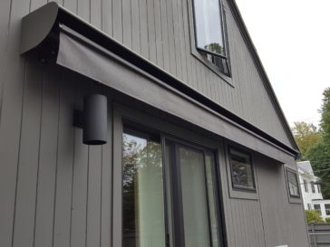 Awning hood protects and blends