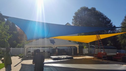Colorful Sail shades in Natick MAprotect this great outdoor living space