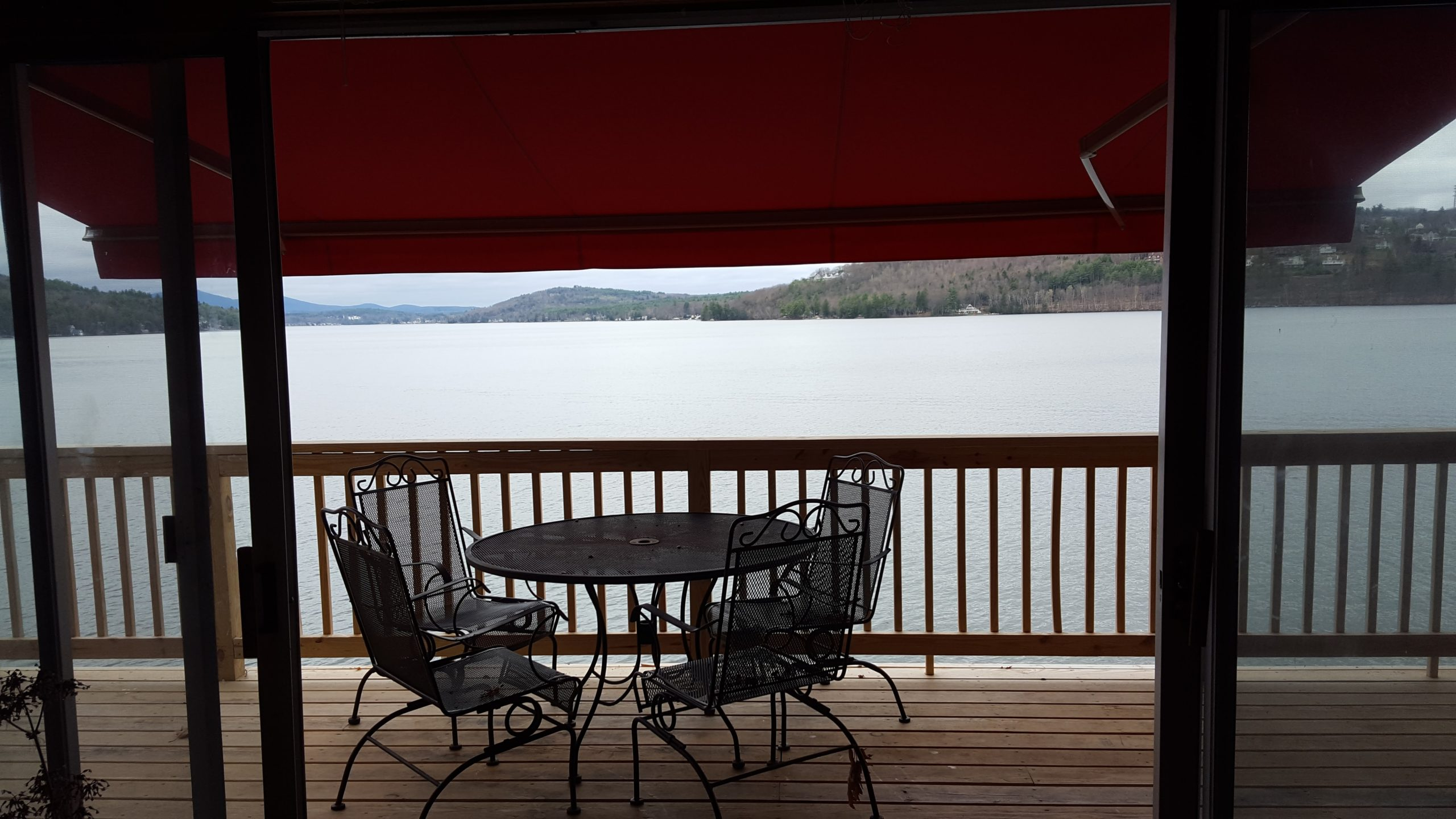 outdoor red awning on a wood deck