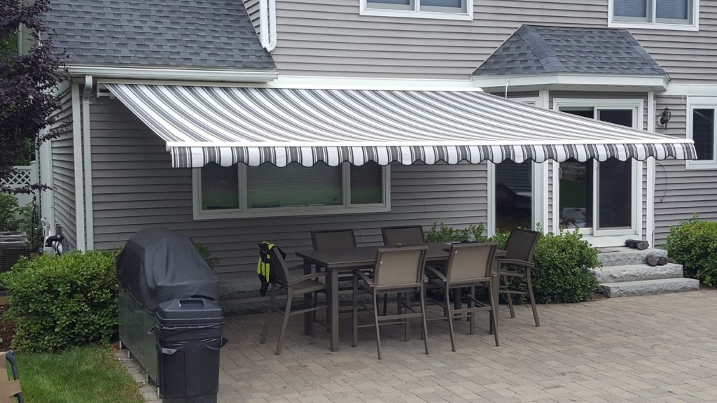 brick patio and a new sunesta awning install