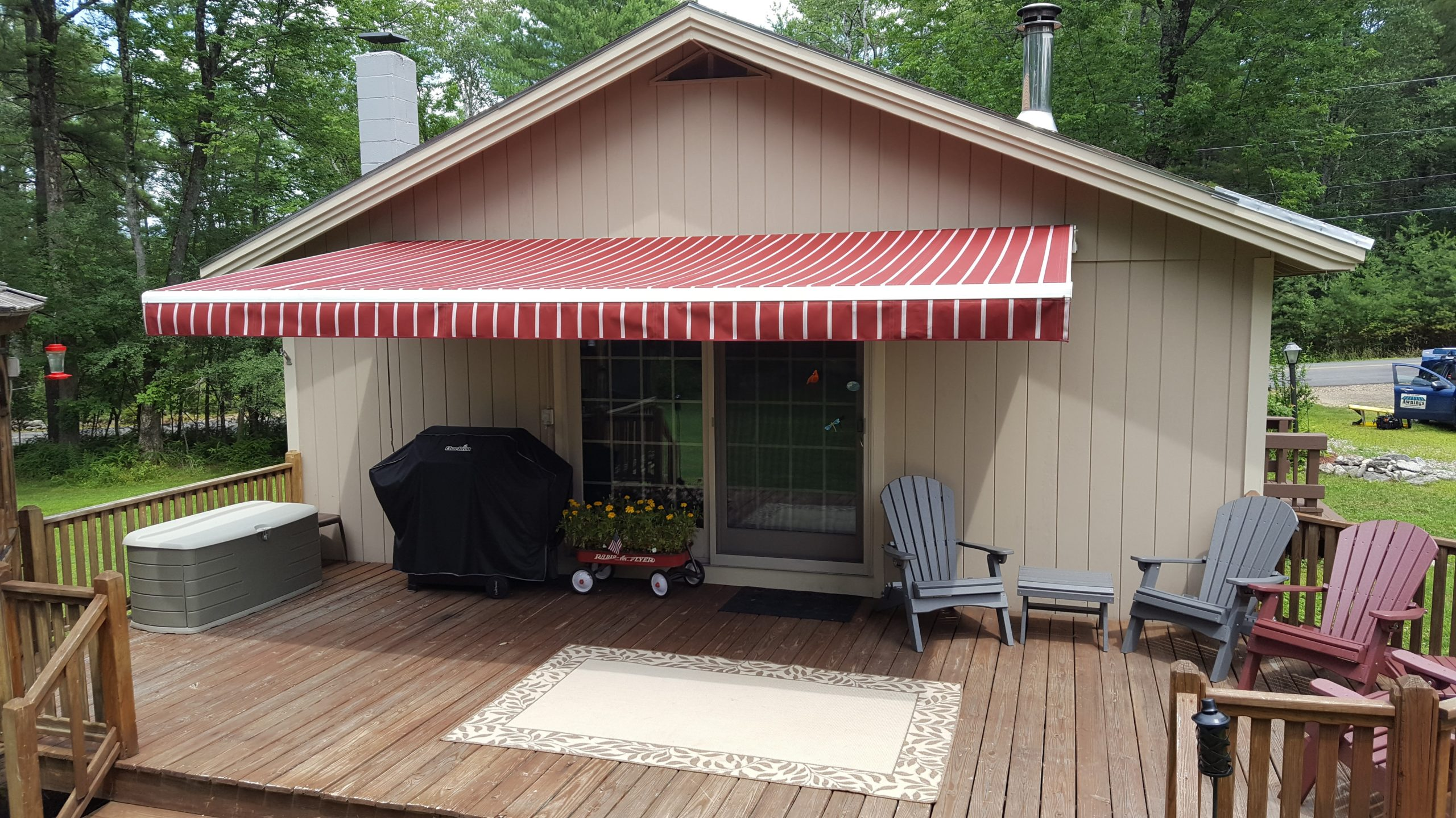 cute red striped awning on a small house