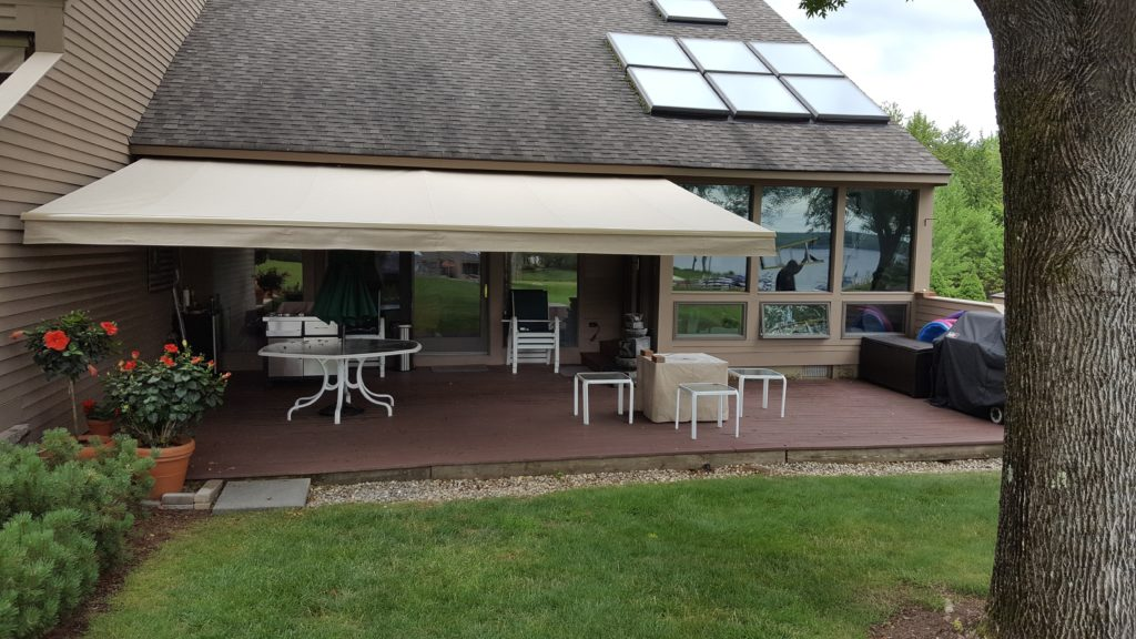 striking white awning against a wood deck