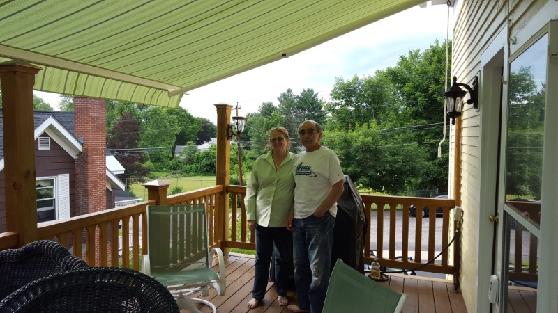 happy couple under new awning in keene nh