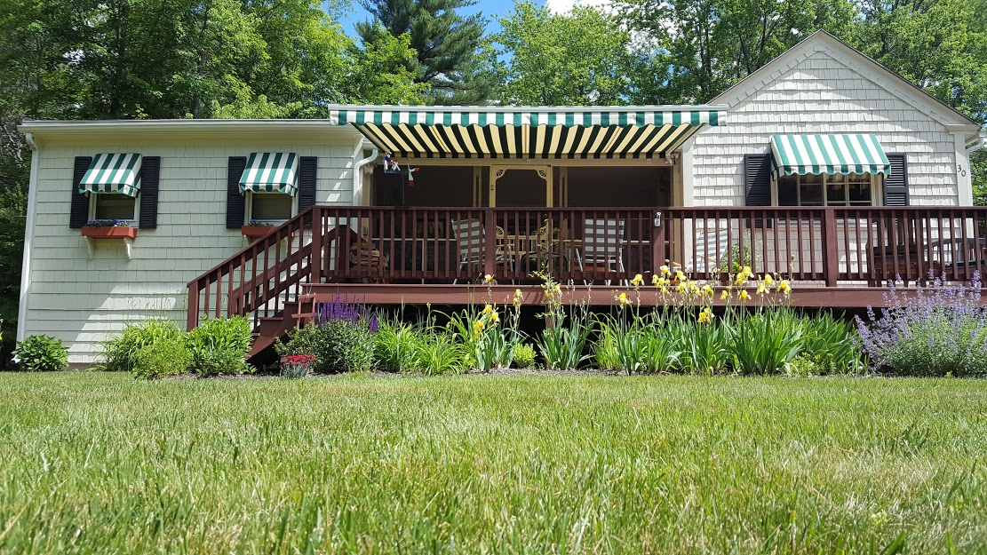green striped awnings instlled on a house