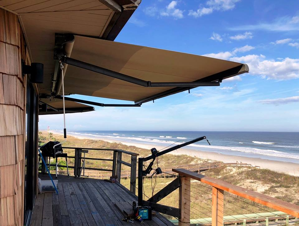 rainier awning installed on a beachfront home