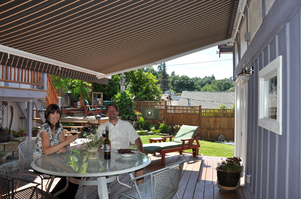 a couple enjoying a drink under their new awning
