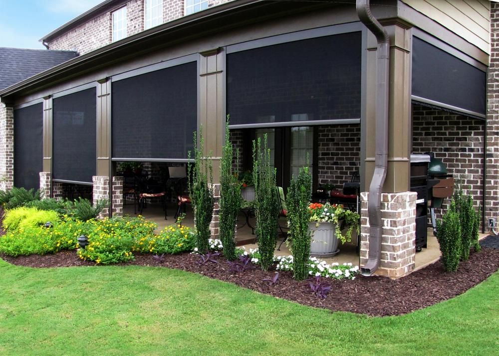 retractable screens on a brick house