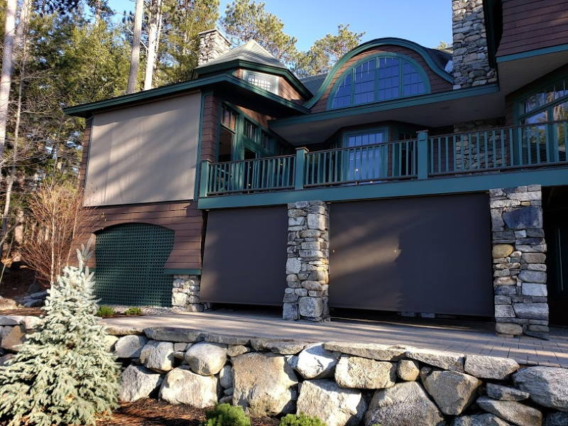 solar screens on a stone house