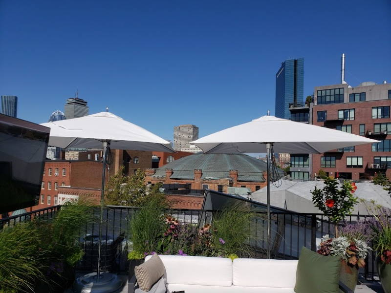 tucci umbrellas on an urban rooftop