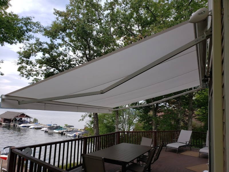 large white awning over a lakehouse