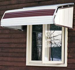 2 tone metal awning over window